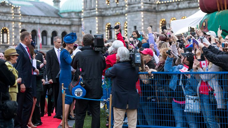 Crowds greeting the Royals in Victoria