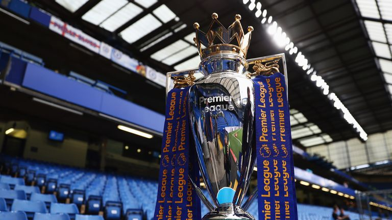 The Premier League trophy on display prior to the Premier League match between Chelsea and Liverpool at Stamford Bridge
