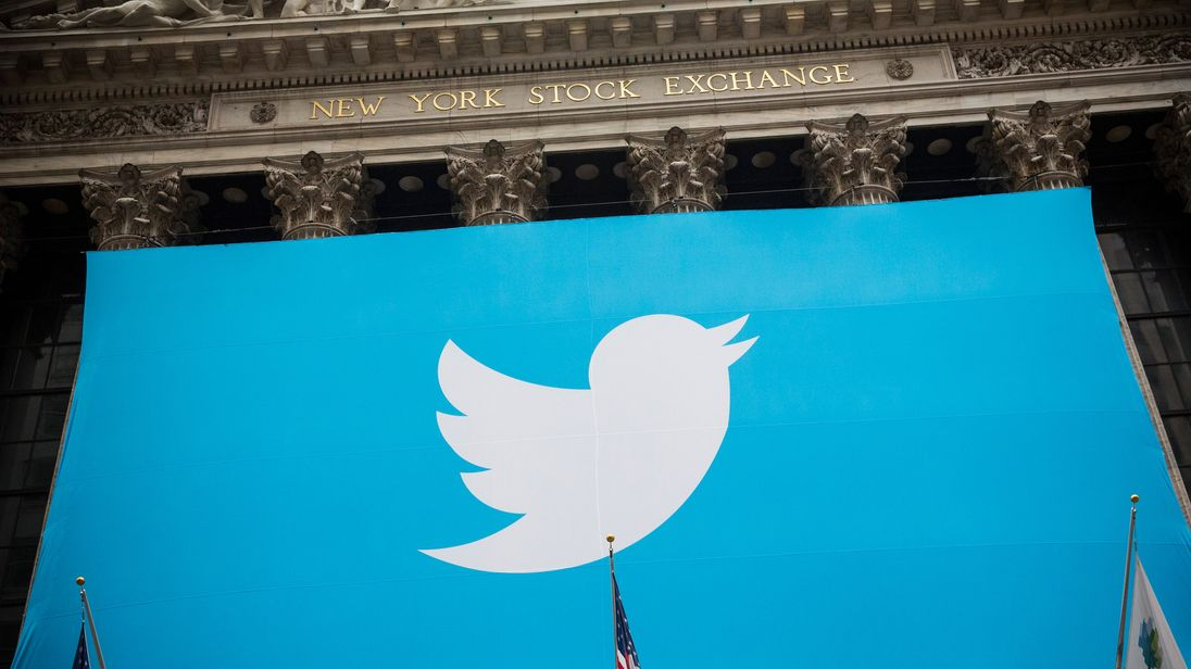 The Twitter logo is displayed on a banner outside the New York Stock Exchange