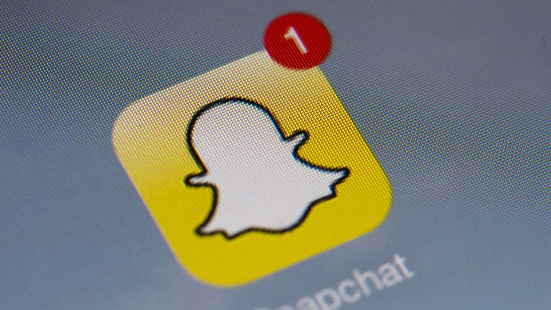 The logo of mobile app 'Snapchat' is displayed on a tablet
