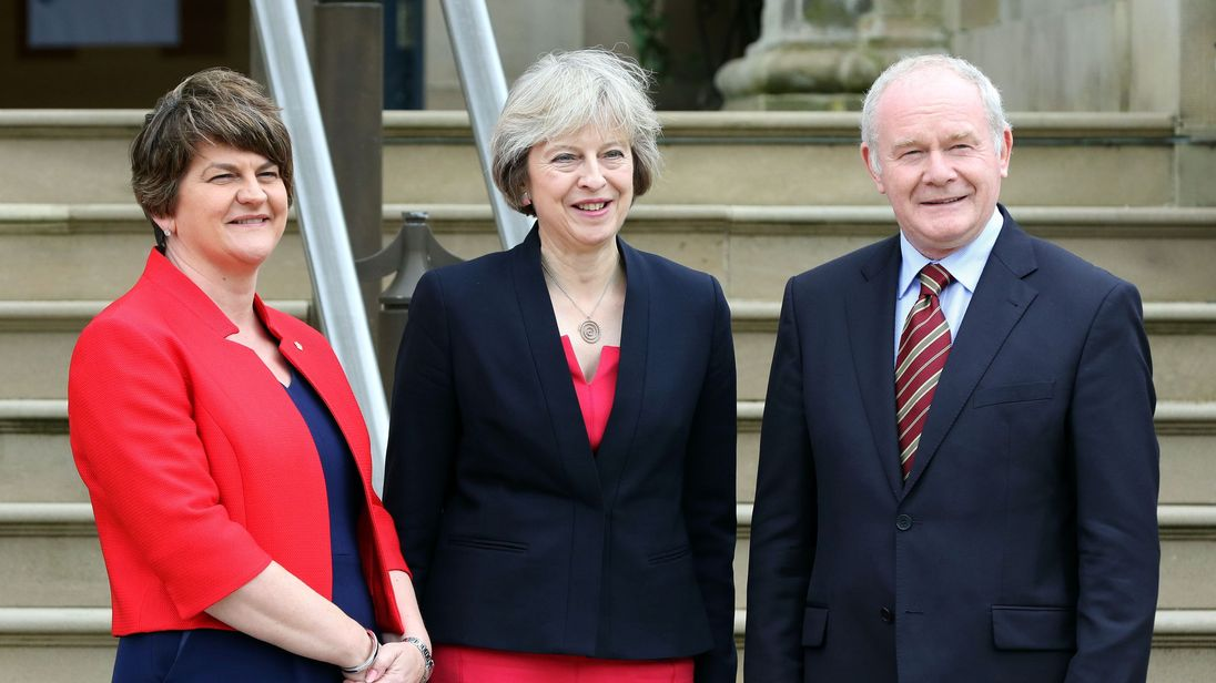 Theresa May, (C), with Northern Ireland First Minister Arlene Foster and Deputy First Minister Martin McGuinness