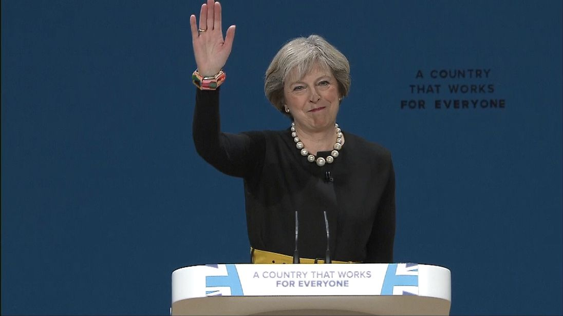 Theresa May waves after delivering her first Tory conference speech as party leader.