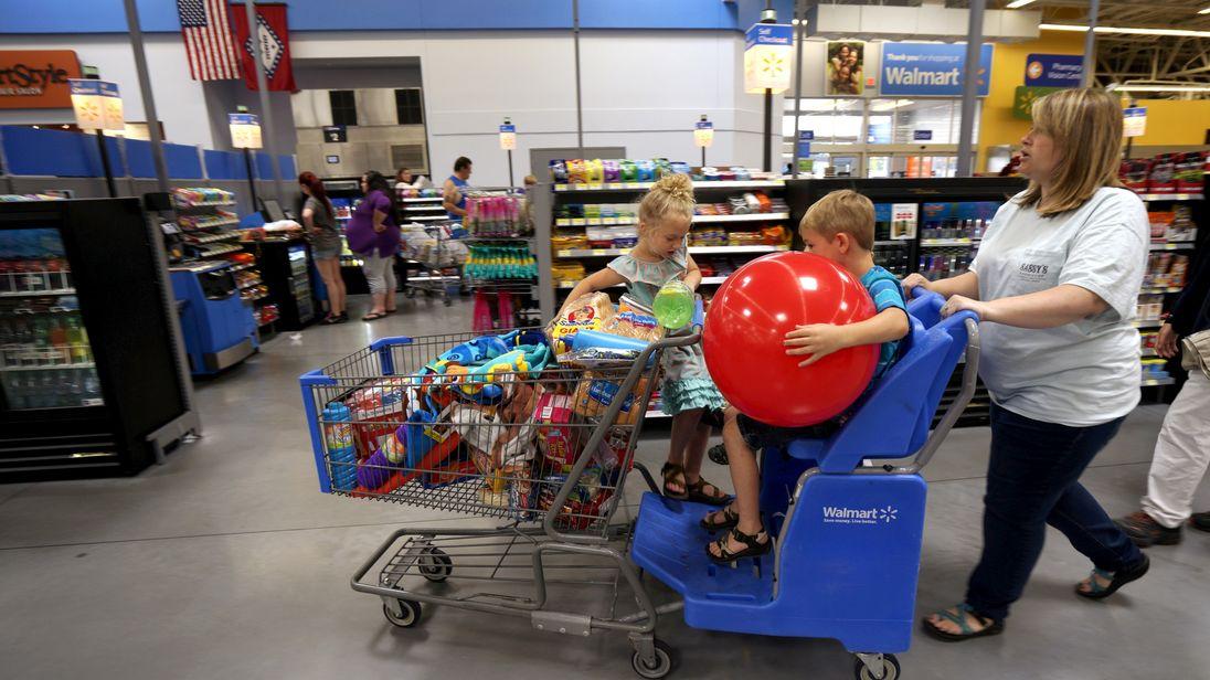 A family shops at the Wal-Mart Supercenter in Springdale, Arkansas