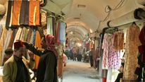 Vendors talk inside one of Aleppo's 37 old souks in Syria March 7, 2006.