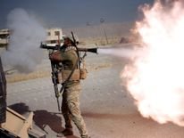 An Iraqi special forces soldier fires a RPG during clashes with Islamic States fighters in Bartella