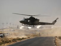 A helicopter lands on a road in Nawran village, some 10km north east of Mosul