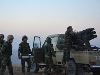 Peshmerga forces gather in the east of Mosul to attack Islamic State militants