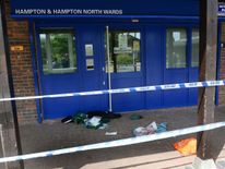 The scene of a multiple stabbing outside a Sainsbury's car park in Hampton, west London