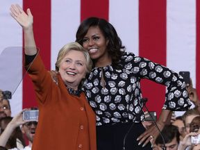 Hillary Clinton and Michelle Obama on stage