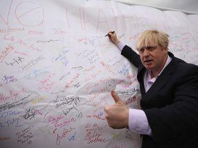 "Boris Johnson attends a ""No to Heathrow"" expansion rally"