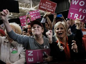 Woman supporters cheer Donald Trump as he speaks at a rally in Cleveland, Ohio
