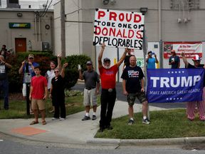 Supporters watch Donald Trump's motorcade arrive for a rally in High Point, North Carolina,