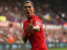 Liverpool's Roberto Firmino celebrates his goal against Swansea in the Premier League