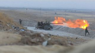 Iraqi forces battle for control of territory outside of Mosul