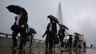 Commuters headinto the City of London across London Bridge