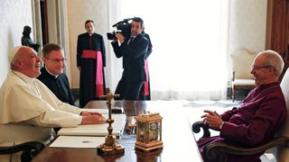 Pope Francis and Justin Welby share a joke during their talks