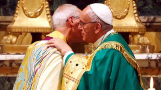 The church leaders embrace after vespers prayers in Rome