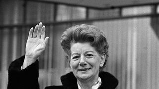 Jean Alexander waves to fans as she arrives to film her last performance in the soap opera in December 1987