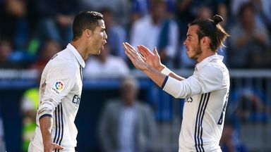 Ronaldo hat-trick keeps Real top