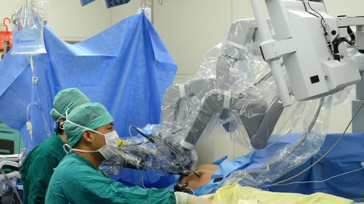 Surgeons in China operate a da Vinci surgical robot to remove a tumour