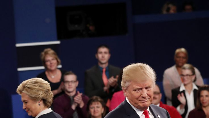 Donald Trump and Hillary Clinton take the stage at the start of their presidential town hall debate