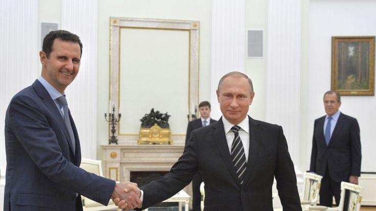 Russia's Vladimir Putin shakes hands with Syria's Bashar al Assad