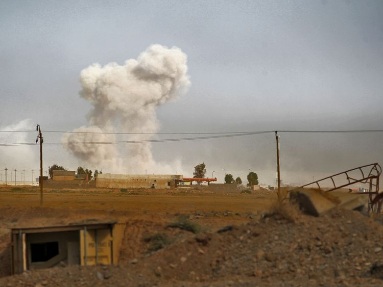 Smoke billows as Iraqi forces deploy in the area of al-Shurah