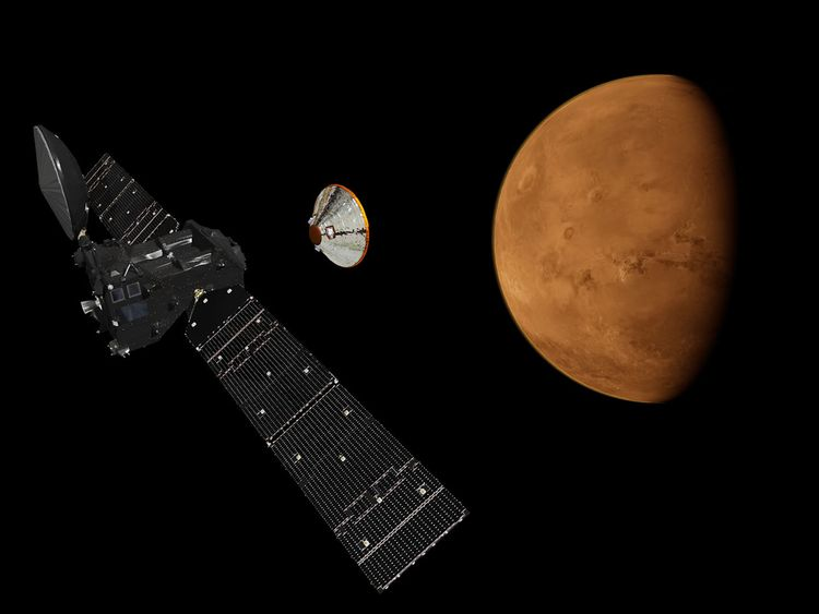 Artist's impression issued by European Space Agency of Schiaparelli lander detaching from the ExoMars Trace Gas Orbiter.