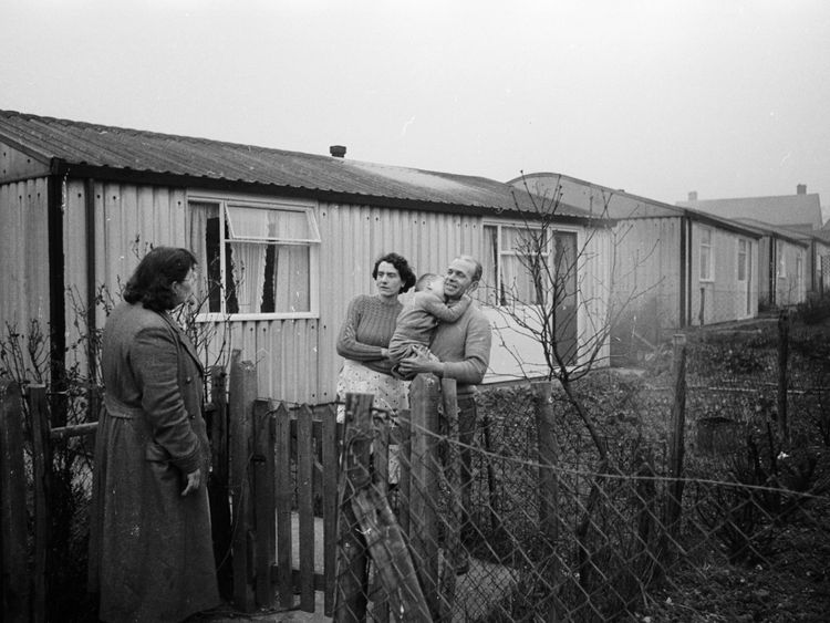 January 1957: Mr and Mrs Ralph Fulcher of Chigwell, Essex, discuss their upcoming emigration to Canada with a neighbour over the fence of their prefab bungalow. The Fulchers are just one of thousands of families who leave Britain each year in search of a better life abroad. (Photo by Harry Kerr/BIPs/Getty Images)
