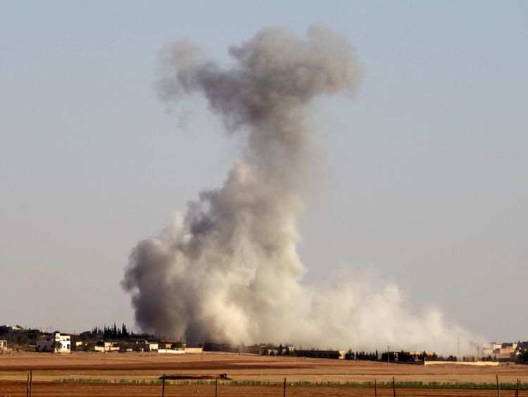 Smoke rises from airstrikes on a village in northern Aleppo countryside