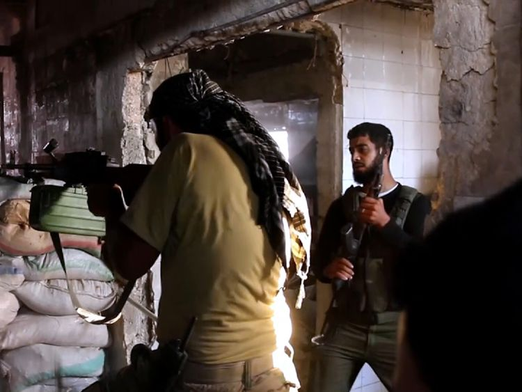 Syrian resistance fighters defend their position in the city of Aleppo