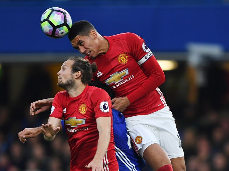 Chris Smalling of Manchester United wins a header during the Premier League match against Chelsea