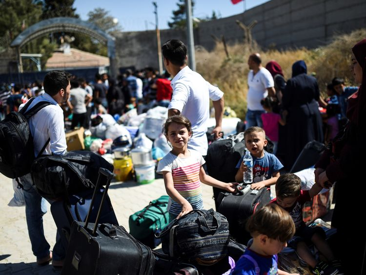 Refugees on their way back to Jarabulus after it was freed in September from Islamic State