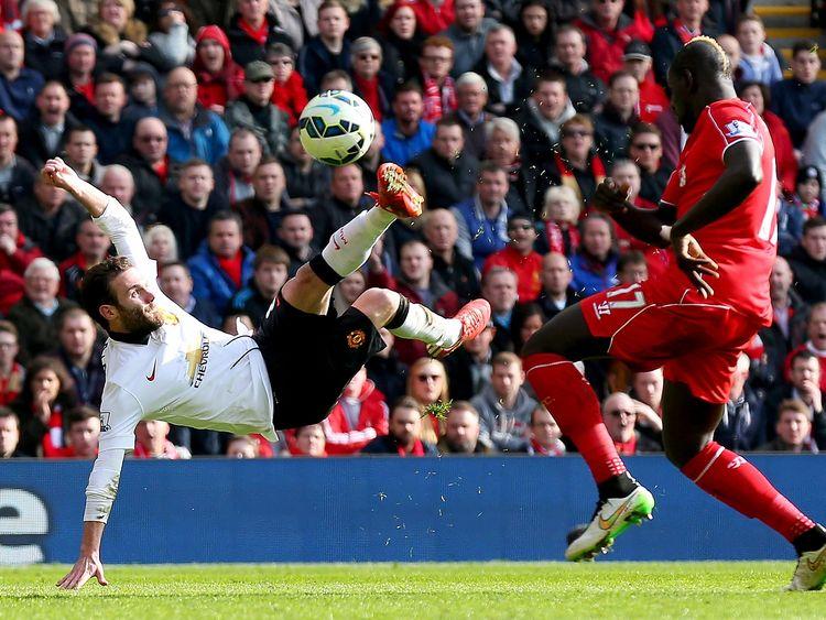 Juan Mata scores an acrobatic goal against Liverpool at Anfield