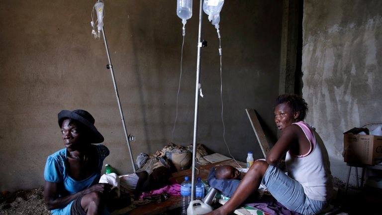 Two women take care of two children receiving treatment for cholera after Hurricane Matthew in the Hospital of Port-a-Piment, Haiti, October 9, 2016. REUTERS/Andres Martinez Casares TPX IMAGES OF THE DAY