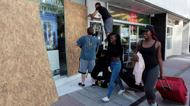 Businesses have been boarded up in Miami Beach, Florida, in preparation