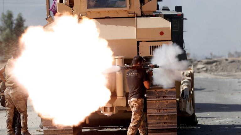 An Iraqi special forces soldier fires an RPG during clashes with Islamic States fighters in Bartella