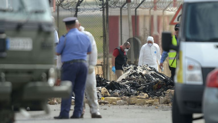 Forensics work on the site of a small plane crash at Malta International Airport