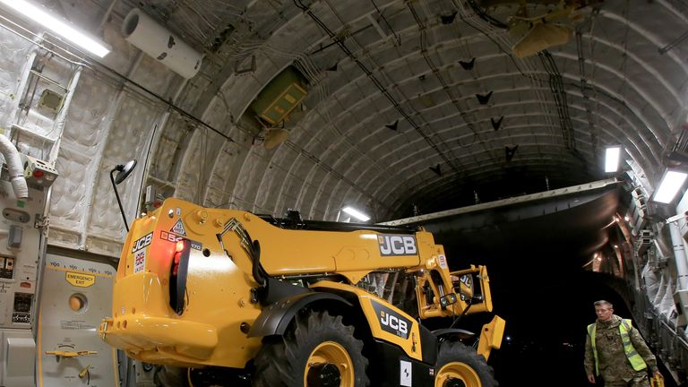 A JCB is sent by the Government to the Philippines to help in the wake of Super Typhoon Haiyan