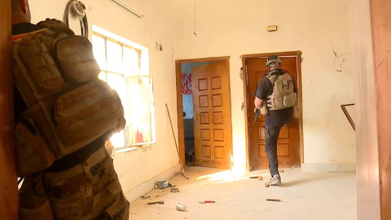 Iraqi troops enter a house to check for Islamic State fighters