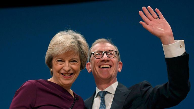 Theresa May stands with her husband Philip after giving her speech