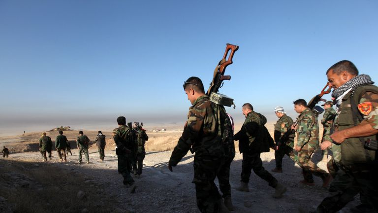 Peshmerga forces walk in the east of Mosul during operation to attack Islamic State militants