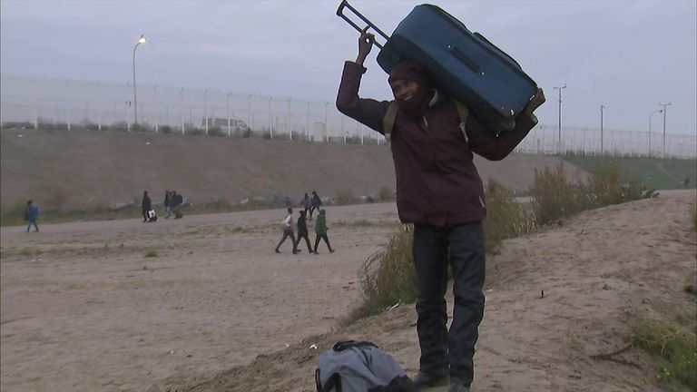 A migrants from Sudan leaving the Calais camp