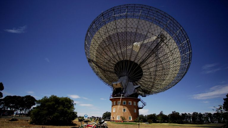 PARKES, AUSTRALIA - OCTOBER 27: (EDITORS NOTE: A POLARIZING FILTER WAS USED IN THE CREATION OF THIS IMAGE): The Australian Commonwealth Scientific and Industrial Research Organisation's (CSIRO) Australia Telescope National Facility (ATNF) Parkes Observatory radio telescope points to the sky October 27, 2006 in Parkes, Australia. The telescope, affectionately known as 'The Dish' is currently observing pulsars at the centre of the Milky Way galaxy. The Dish is one of the largest radio telescopes i