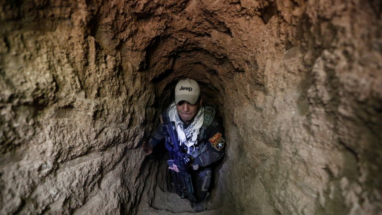 An Iraqi special forces soldier inside a tunnel used by Islamic State militants in Bazwaia, east of Mosul, Iraq