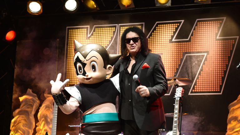 Gene Simmons of KISS poses with Japan's animation character Astro Boy as the exhibition Kiss Expo Tokyo 2016 is announced in the Japanese capital