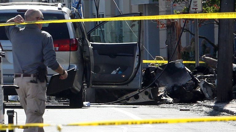 Investigators at the scene of the plane crash in downtown East Hartford, Connecticut