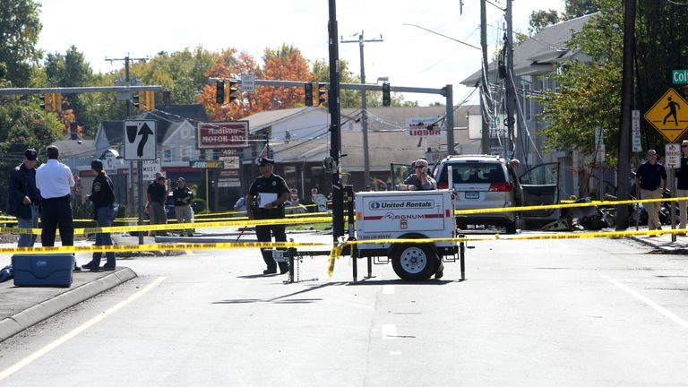 Investigators at the scene of a plane crash in downtown East Hartford, Connecticut