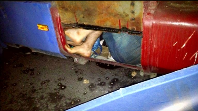A migrant is found to have been smuggled in a fuel tank