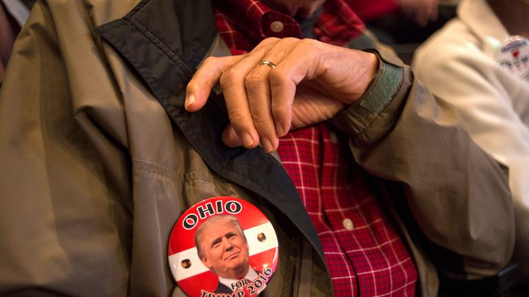 A Donald Trump supporter waits to hear him speak at a rally in Cincinnati, Ohio